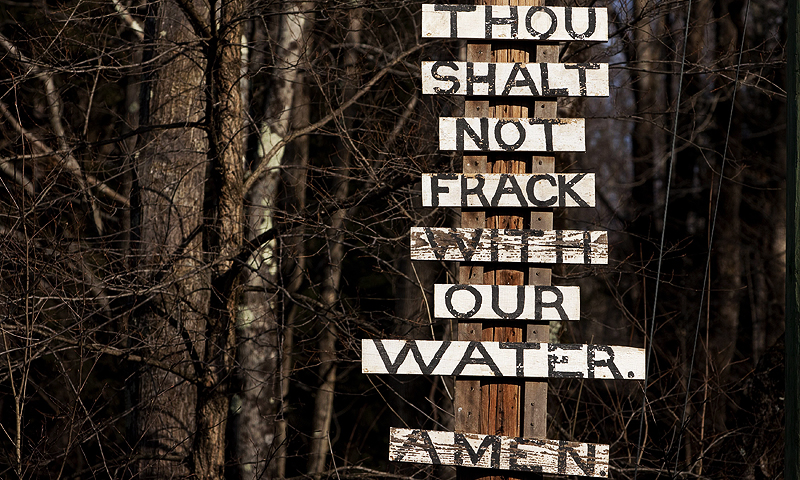 Signs protesting the process of hydraulic fracturing, also known as fracking, are seen near the town of Calicoon Center, New York.  The oil and gas industry is finding that less is more in the push to treat and recycle water used in the hydraulic fracturing process.—Photo by Reuters