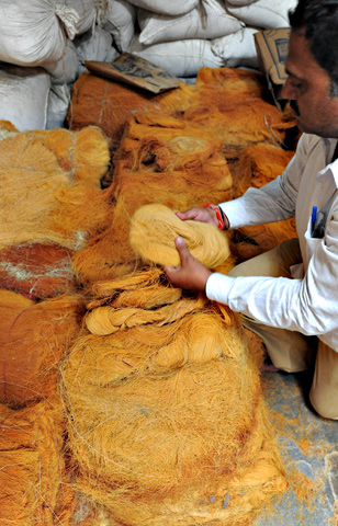 Indian owner, Vipulbhai inspects roasted 'sev' (vermicelli) at a cottage industry area in Ahmedabad. — AFP Photo