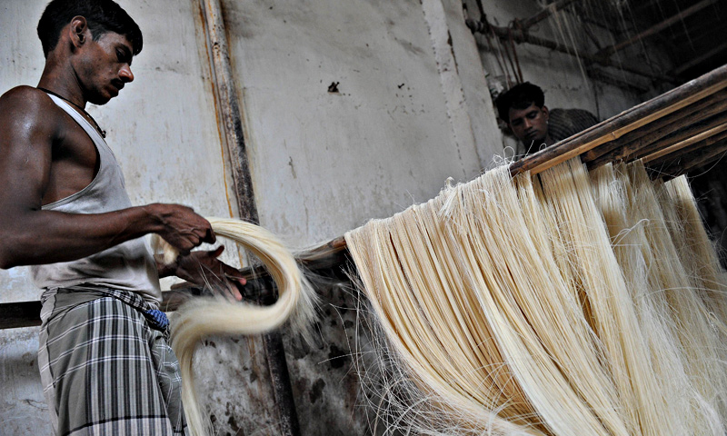 Indian workers prepare 'sev' (vermicelli) at a cottage industry area in Ahmedabad. — AFP Photo
