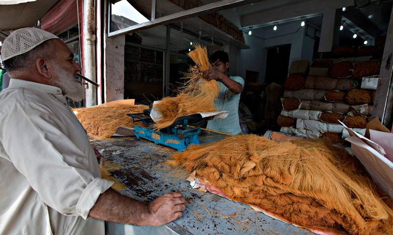 A man buys vermicelli, a specialty eaten during the Muslim holy month of Ramadan, at a shop in Rawalpindi. — Reuters Photo