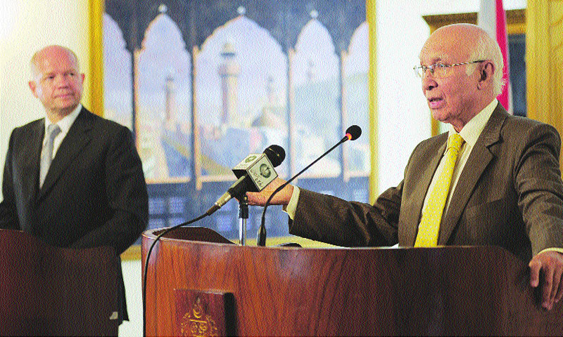 British Foreign Secretary William Hague (L) looks on during a joint press conference as Sartaj Aziz (R), Pakistan's adviser for National Security and Foreign Affairs, speaks at the Foreign Ministry in Islamabad.—Photo by Tanveer Shahzad/Dawn