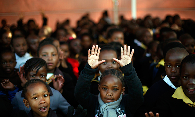 Students sing happy birthday in Johannesburg. — AP Photo