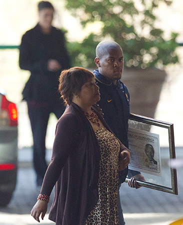 Nelson Mandela's daughter Zindzi arrives at Mediclinic Heart Hospital in Pretoria, where Mandela is being treated. — AP Photo