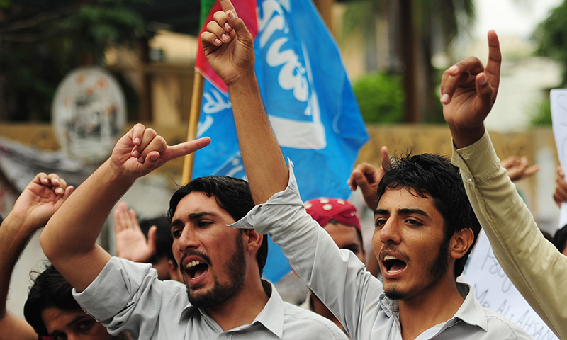 Supporters of the Islami Jamiat-e-Taliba, student wing of religious political party Jamat-e-Islami, protest against the verdict of Bangladesh war crimes tribunal in Karachi. — AFP Photo
