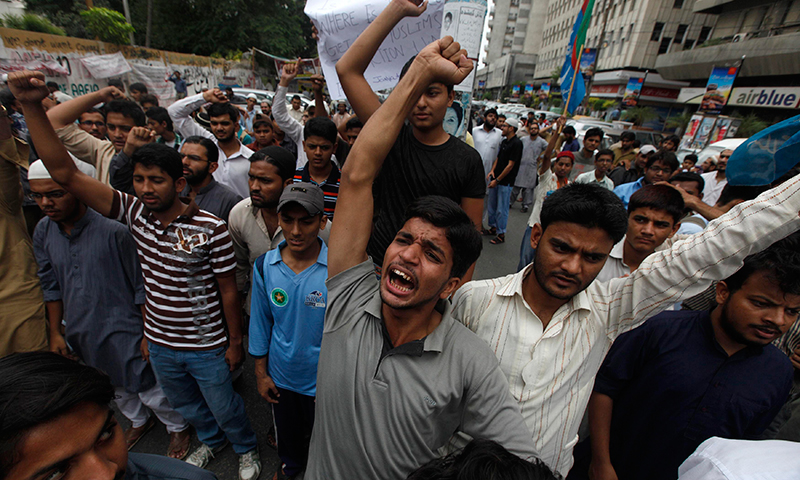 Protesters chant slogans in Karachi. — Reuters