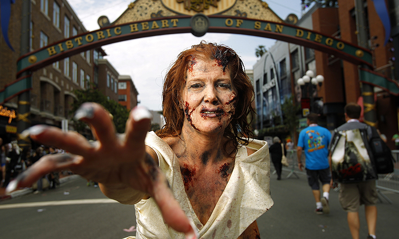"Amy Stone dressed, dressed as a ""walker"" to promote The Walking Dead Escape, poses for a photo.—Photo by AP"