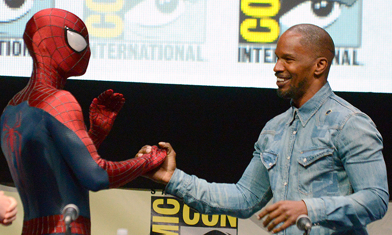 "Spider-Man, left, and Jamie Foxx attend the ""The Amazing Spider-Man 2"" panel on Day 3 of Comic-Con International.—Photo by AP"
