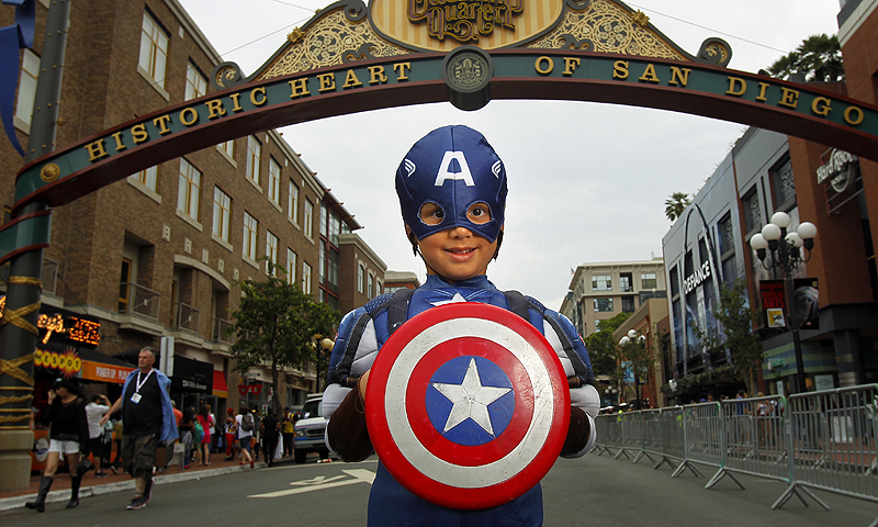 Atticus Khan poses for a photo dressed as Captain America at Comic-Con.—Photo by AP