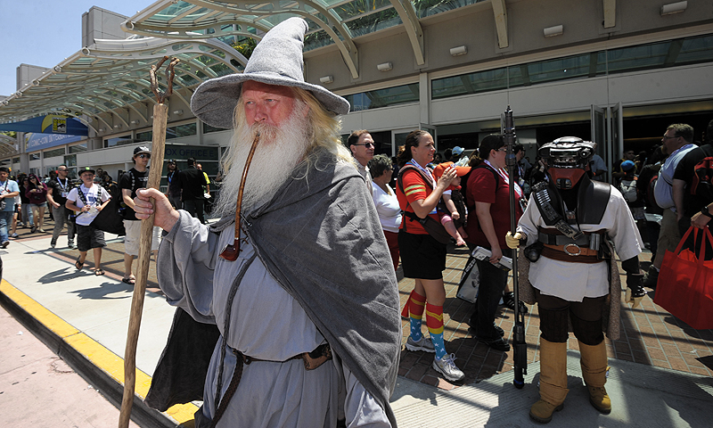 Wilfred Harris, dressed as Gandalf, walks out of the San Diego Convention center on Day 2 of the 2013 Comic-Con International Convention.—Photo by AP
