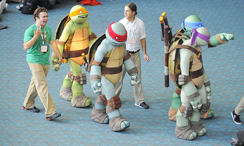 Teenage Ninja Turtle characters walk through the San Diego Convention Center during the Preview Night event.—Photo by AP