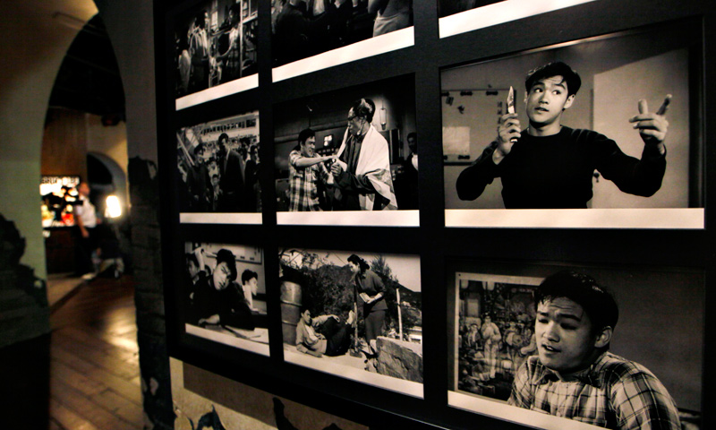 "Pictures of movie scene are displayed at the Lee's memorial exhibition ""Bruce Lee: Kung Fu, Art, Life"" at the Hong Kong Heritage Museum."