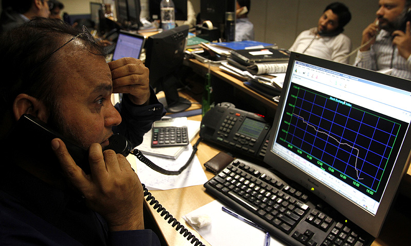 Pakistani stock brokers monitor a market at the Karachi Stock Exchange in Karachi, Pakistan. -Photo by AP