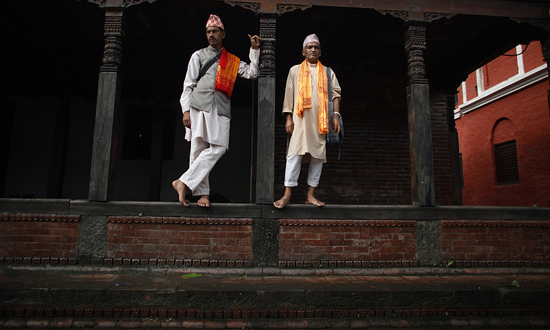 "Nepalese priests take rest after performing rituals during the first Monday of ""Shravan"" at Pashupatinath temple in Katmandu, Nepal.—Photo by AP"