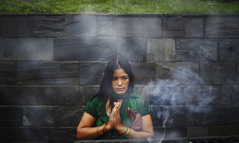 A woman offers prayers at Pashupatinath temple to mark the Shrawan Sombar festival in Kathmandu.—Photo by Reuters
