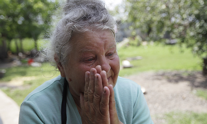 The mother of rape victim Irina Krashkova, 69-year-old Maria cries during an interview with the Associated Press, in the town of Vradiyevka, southern Ukraine. Corruption, lawlessness and the impunity of government officials and their wealthy friends, be it a national lawmaker, a businessman in an expensive car or a small town cop, have increased significantly since the 2010 election of President Viktor Yanukovych, watchdogs say.—Photo by AP