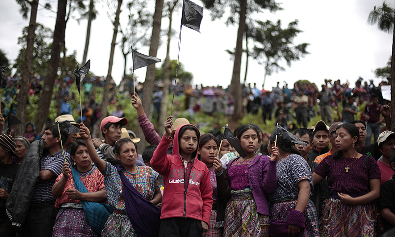 Local residents of San Juan Sacatepequez hold black flags as a symbolic act of mourning, during a protest against the inauguration of the construction of Cementos Progreso Company, a cement factory in San Juan Sacatepequez, 30 km (18 miles), from Guatemala City. Thousands of local residents protested against the construction of the factory on Friday, saying the factory will cause economic and ecological damage to the community, according to local media.—Photo by Reuters