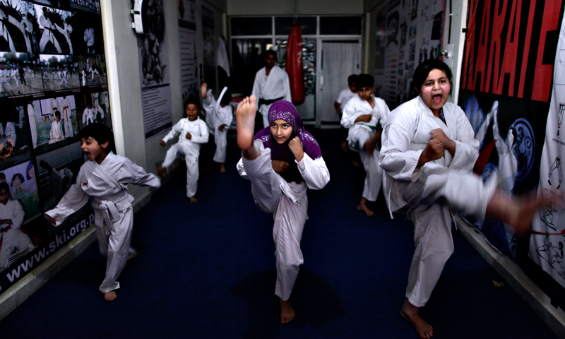 Schoolgirls, Shazil Ishtiaq, 12, right, and Aysha Huma, 9, center, attend a Karate class at Shotokan Karate School in Islamabad.