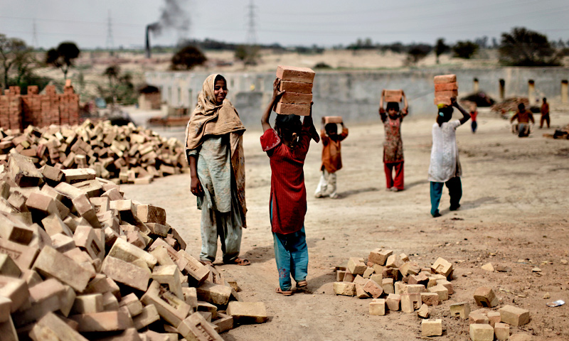 Girls  forced to skip schools due to poverty, work in a brick factory, in Mandra.