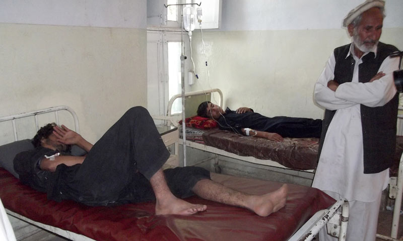 Villagers injured in Parachinar's bomb blasts at a local hospital in the northwestern town. — Photo by AP