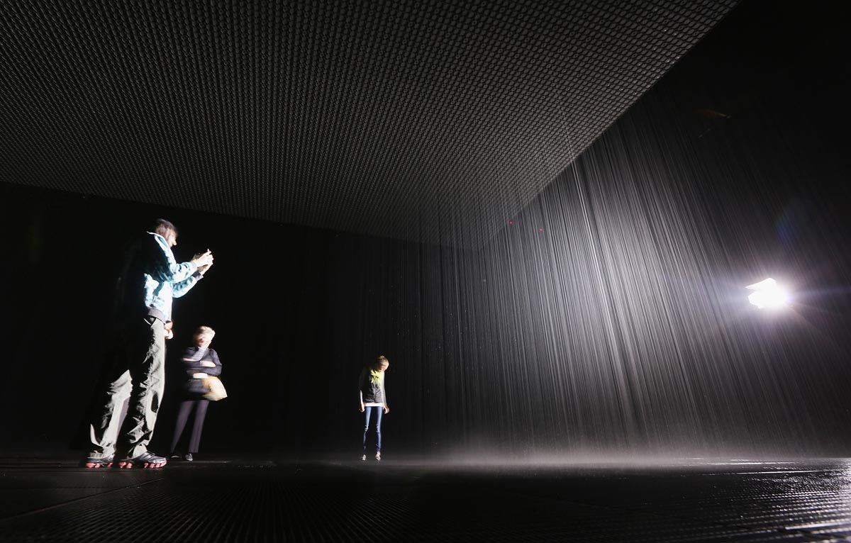 Visitors gather in the new 'Rain Room' installation at the Museum of Modern Art (MoMA) in Manhattan on May 15, 2013 in New York City. — AFP Photo