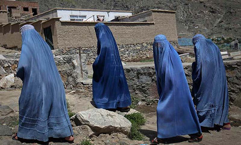 Afghan women clad in burqas walk up a hill at the old part of Kabul, May 10, 2012. — Reuters File Photo