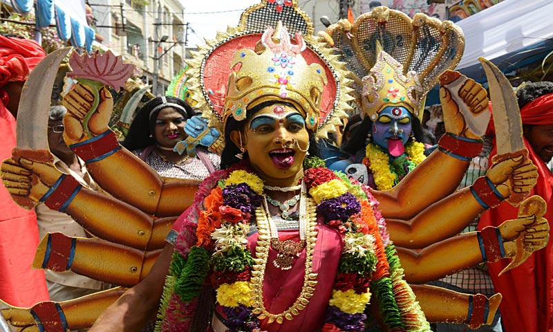 An Indian Hindu devotee dressed as the Hindu Goddess Maha Kali performs in the street during the Bonalu festival at the Sri Ujjaini Mahakali Temple in Secunderabad, the twin city of Hyderabad. The Goddess Kali is honoured mostly by women during Bonalu festival by offerings of food and dancing. — AFP Photo