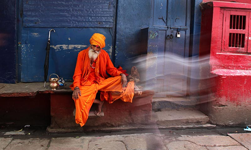 An Indian Hindu holy man rests in an alleyway in Varanasi. Varanasi is among the world's oldest continuously inhabited cities, and one of the most important pilgrimage centers for Hindus who gather here for ritual bathing and prayers on the banks of the Ganges. — AP Photo