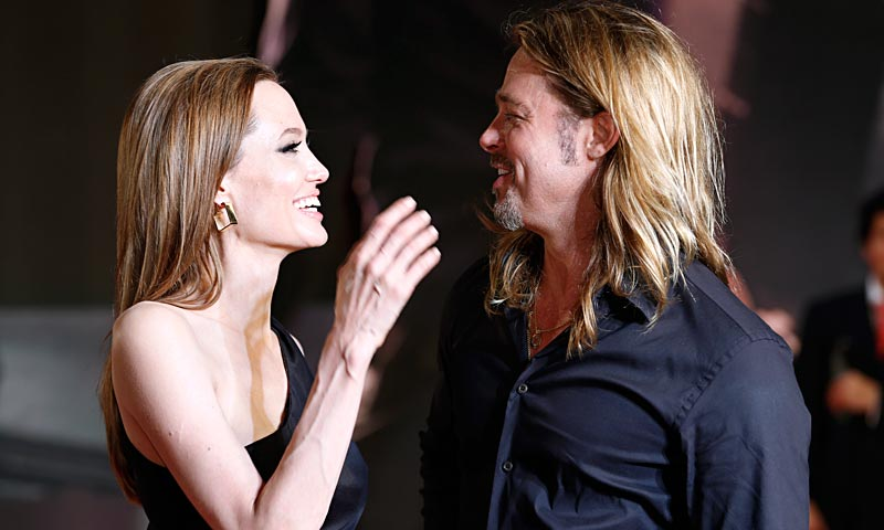 "Brad Pitt and Angelina Jolie look at each other upon arrival for the Japan premiere of his latest film ""World War Z"" in Tokyo.  — AP Photo"