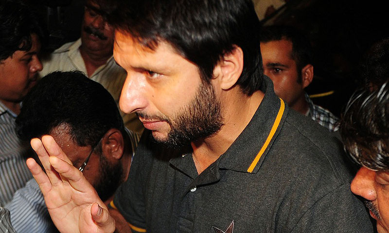 Pakistani cricketer Shahid Afridi arrives at Karachi International Airport. -File photo by AFP