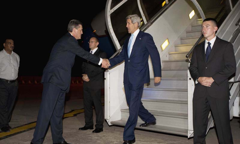 US Secretary of State John Kerry(R) is greeted by US Ambassador to Pakistan Richard Olson (2nd L)  upon his arrival in Islamabad, Pakistan, July 31, 2013. — Photo by AFP