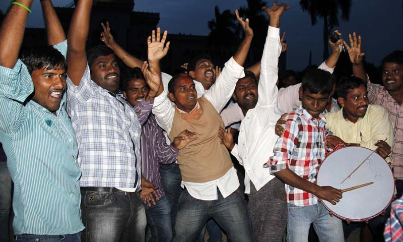 Telangana supporters celebrate after the announcement of the separate state of Telangana, in the southern Indian city of Hyderabad July 30, 2013. — Photo by Reuters