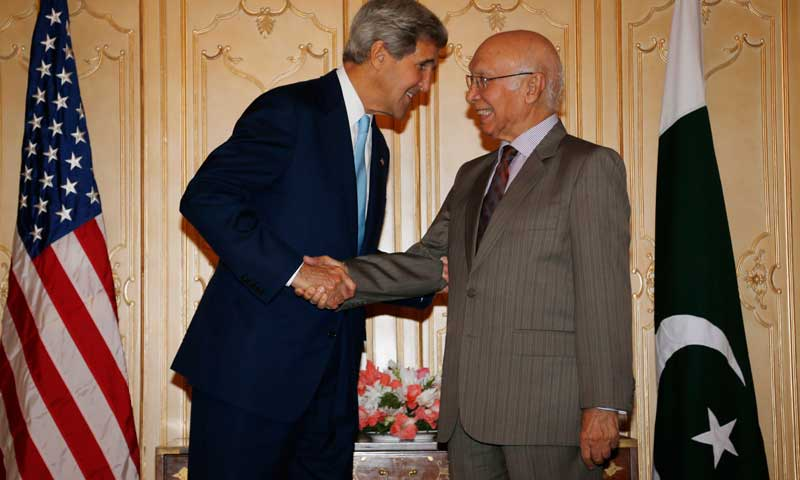 US Secretary of State John Kerry (L) shakes hands with Adviser on Foreign Affairs and National Security Sartaj Aziz in Islamabad on August 1, 2013. — Photo by AFP