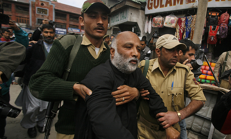 Indian Policemen detain an activist of The All Parties Hurriyat Conference, an umbrella group of separatists, outside a hotel in Srinagar, India.—Photo by AP
