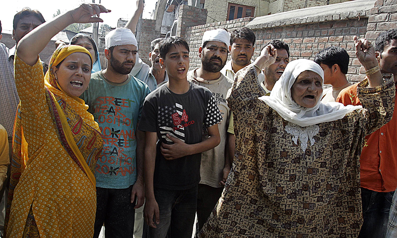 People shout pro-freedom slogans in Indian occupied Kashmir. Authorities imposed an indefinite curfew in Indian Kashmir ahead of a separatist rally, the latest in a series of protests against Indian rule in the disputed Himalayan region.—Photo by Reuters