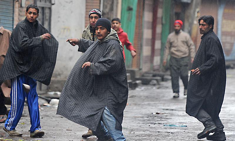 Protestors clash with police in Srinagar.—Photo by AFP