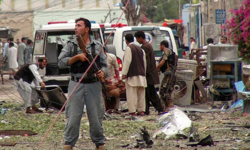 Security officials conduct investigation at the scene of suicide bomb attacks in Jalalabad, August 3, 2013. — Photo by AP
