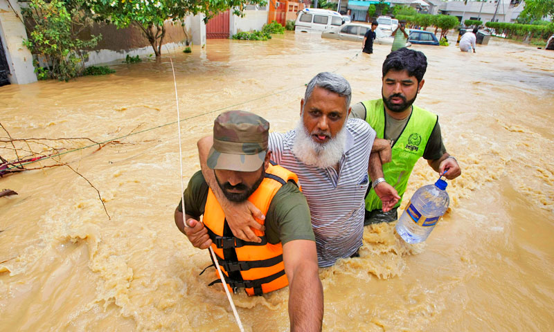 Pakistani soldiers rescue a resident from an area flooded by heavy rains on the outskirts of Karachi, Pakistan, Sunday, Aug. 4, 2013.  – Photo by AP