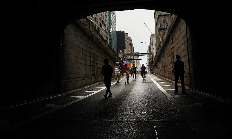 People walk into the Park Avenue Tunnel after it has been temporarily transformed into an art exhibition for pedestrians. — AFP Photo