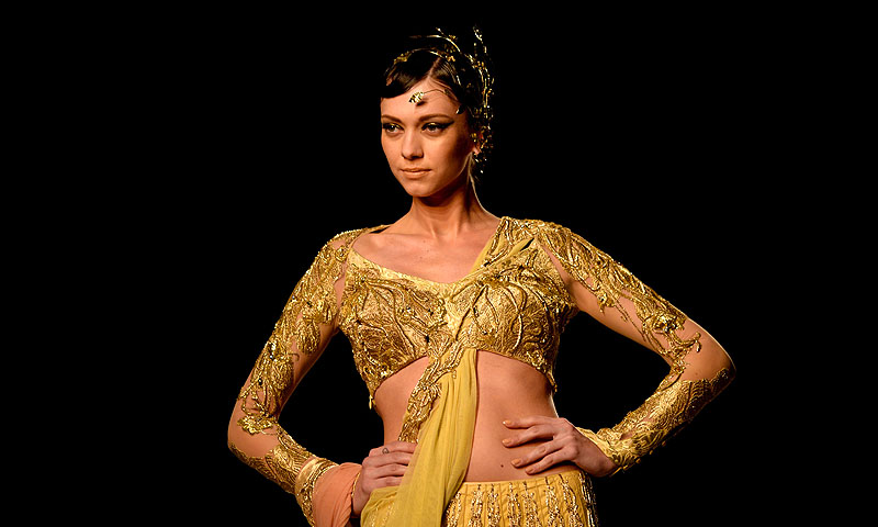 A model presents a creation by Indian fashion designer Gaurav Gupta during the PCJ Delhi Couture Week 2013.—Photo by AFP