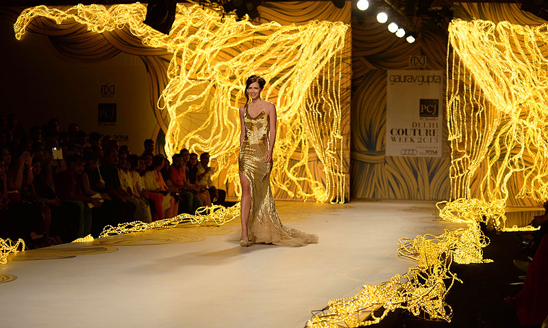 Indian Bollywood actress Kalki Koechlin presents a creation by Indian fashion designer Gaurav Gupta during the PCJ Delhi Couture Week 2013 in New Delhi.—Photo by AP