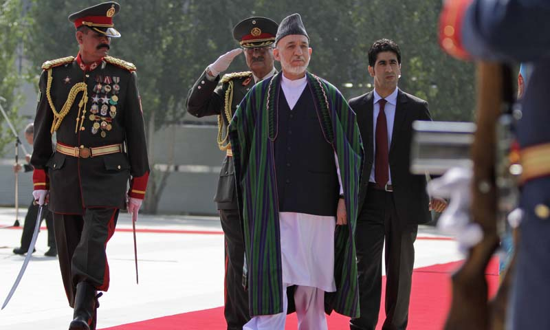 Afghan President Hamid Karzai arrives for  Eid al-Fitr prayer that marks the end of the Muslim holy month of Ramadan in Kabul, Afghanistan, Thursday, August, 8, 2013. — Photo by AP