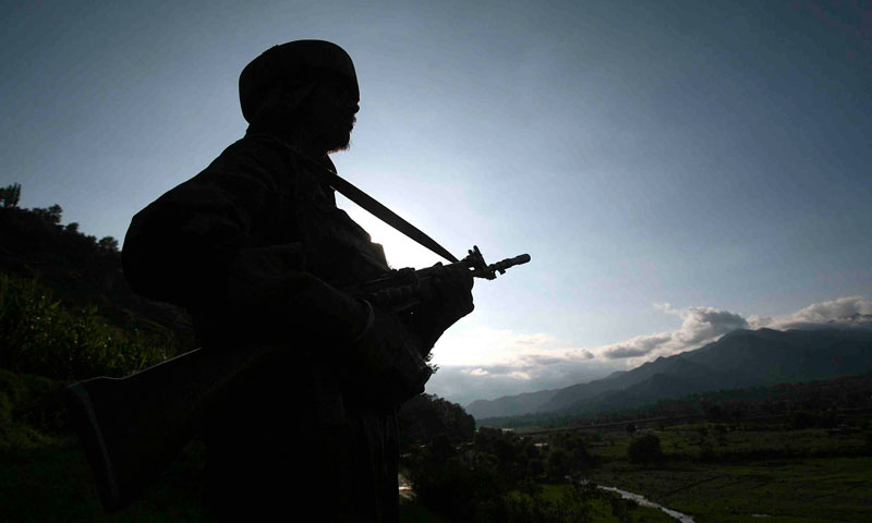 Photo shows an Indian army soldier standing guard while patrolling near the Line of Control (LoC) in Kashmir.—Reuters Photo