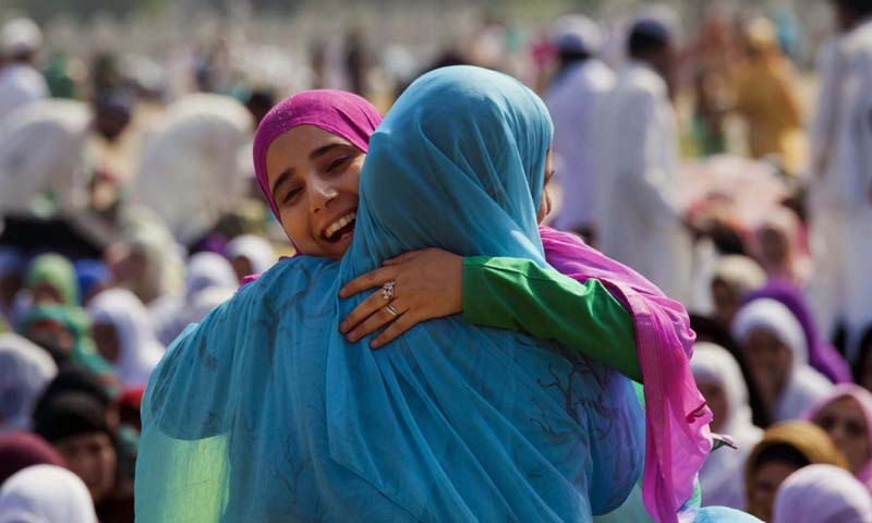 Kashmiri Muslim women hug as they greet each other before offering prayers at Eidgah, or an open-air mosque, in Srinagar, India, Friday, Aug. 9, 2013. — Photo AP
