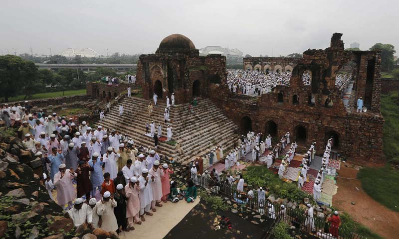 Muslims offer prayers at the ruins of the Feroz Shah Kotla mosque on the occasion of Eid ul-Fitr in New Delhi August 9, 2013. — Photo Reuters.