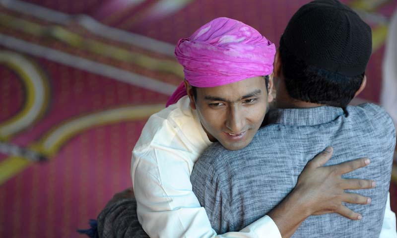 Nepalese Muslims greet each other after performing congregational Eid ul-Fitr prayers at Kashmiri Mosque in Kathmandu on August 9, 2013. — Photo AFP