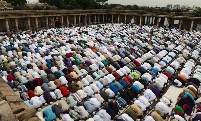 Indian  Muslims offer  Eid ul-Fitr prayers at the 600-Year old Sarkhej Roza in Ahmedabad  on August 9, 2013. — Photo AFP