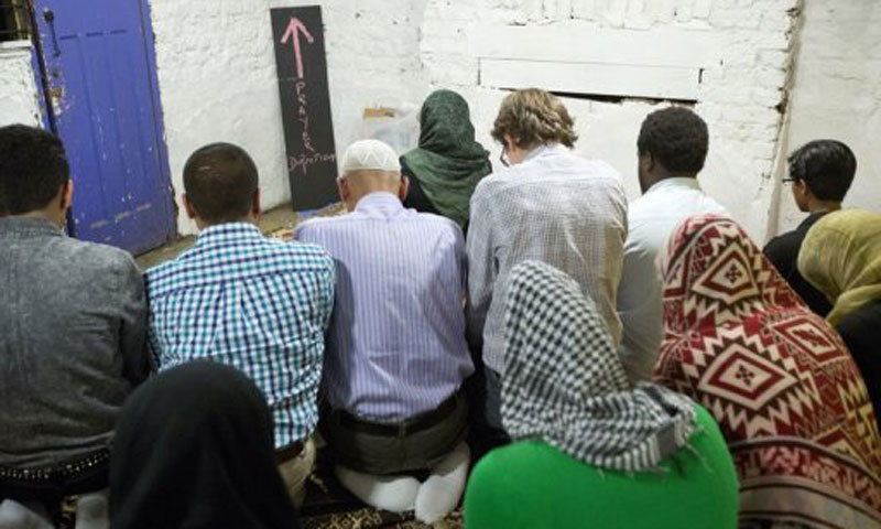 Naima leads prayers in London. - Photo by AFP