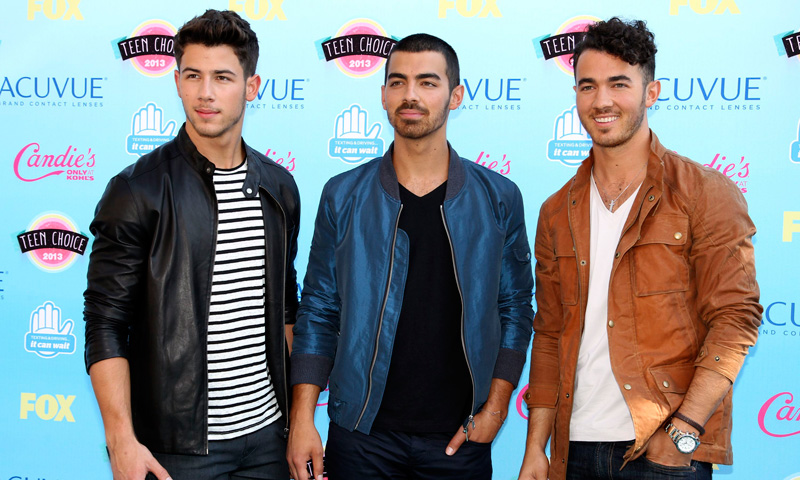 Singers (Left to Right) Nick, Joe and Kevin Jonas pose as they arrive.