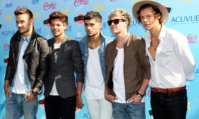 "Members of English-Irish pop boy band ""One Direction"" pose as they arrive."
