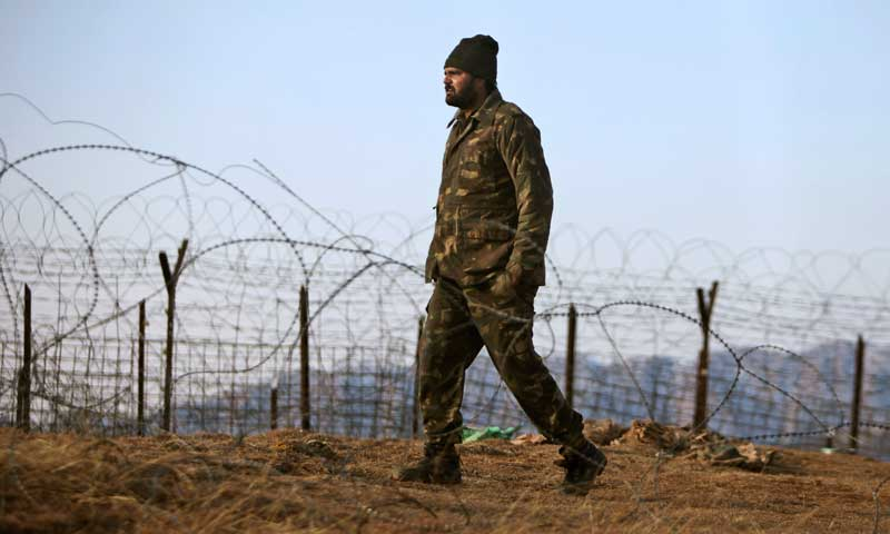 An Indian army soldier patrols near the Line of Control after reported ceasefire violation, in Mendhar, Poonch district. — File photo